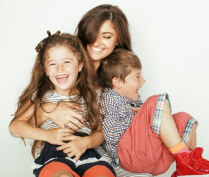 mom and two children smiling