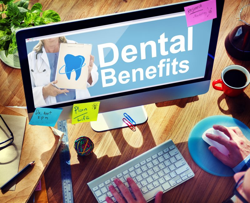 Patient reviewing dental benefits on computer
